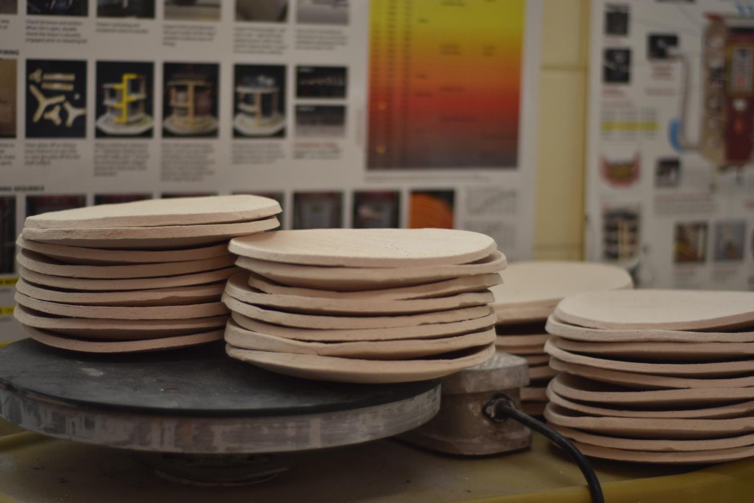 Stacks of bisque plates created by Mrs.Cooke and her daughter are ready for the Art Night