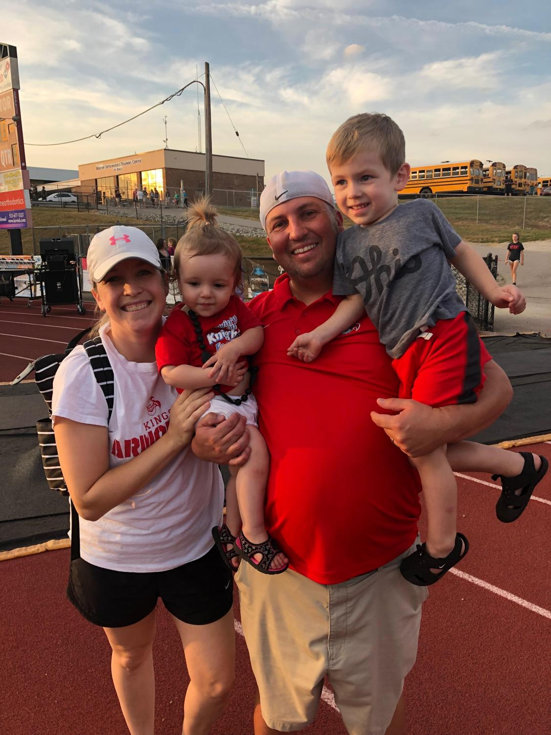 Coach Andy Endress with his wife and two kids