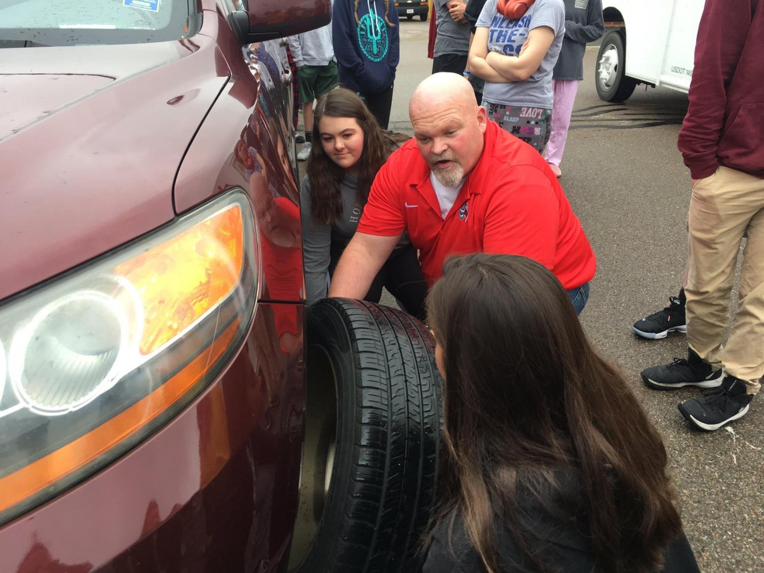 Goldie teaches students to change a tire and jump a car battery (via @KingsEmployabi1 on Twitter)