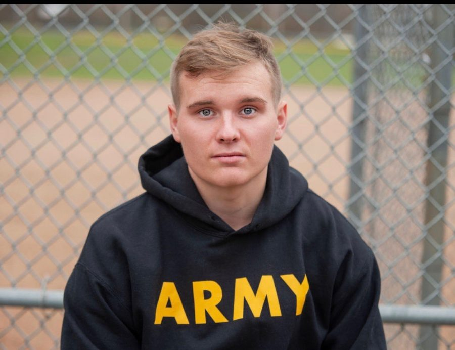 Tyson Marcum poses for his senior pictures in his army gear (photo from Tyson Marcum)