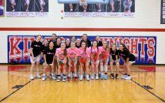 The Lady Knights basketball teams surround the senior class on senior night. Photo via Summer Bush