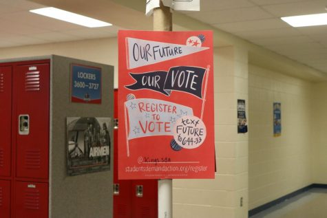 Students Demand Action places signs around the school for their Voter Drive.