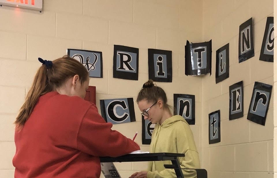 Kaitlyn Beauchamp, helping a student at the writing center