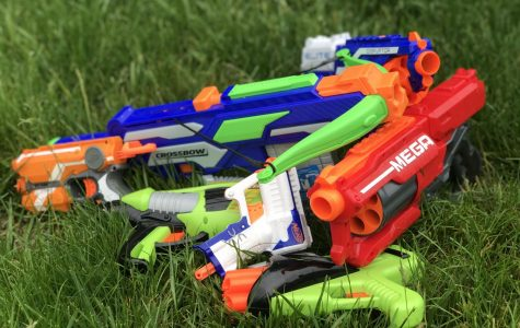 Students choose from a variety of Nerf gun styles to compete in the annual dart wars competition.