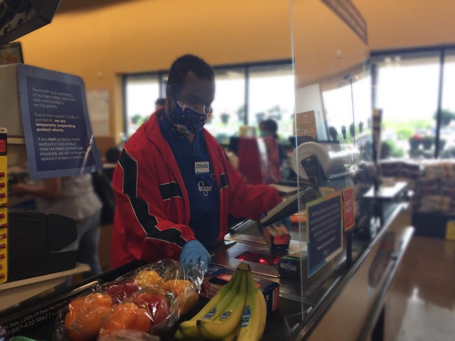 Othello+Gooden+Jr.%2C+essential+worker+at+Kroger%2C+checks+out+customers+using+PPE.