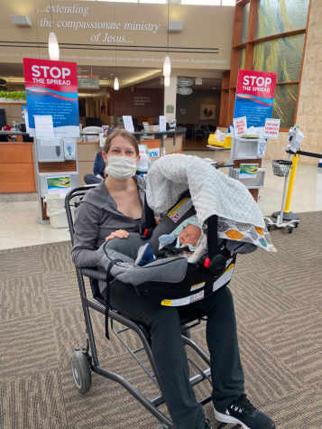 Lisa DeBord, special education teacher, leaves the hospital with her newborn baby born during the COVID-19 pandemic.