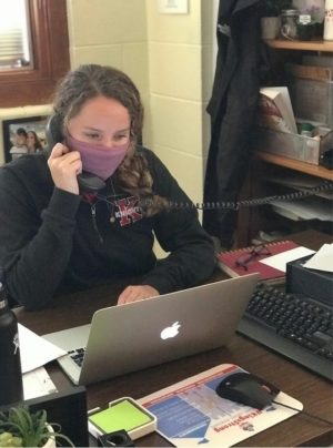Stacey Duckworth takes incoming phone calls from the nurse's office requesting students who need to quarantine immediately.