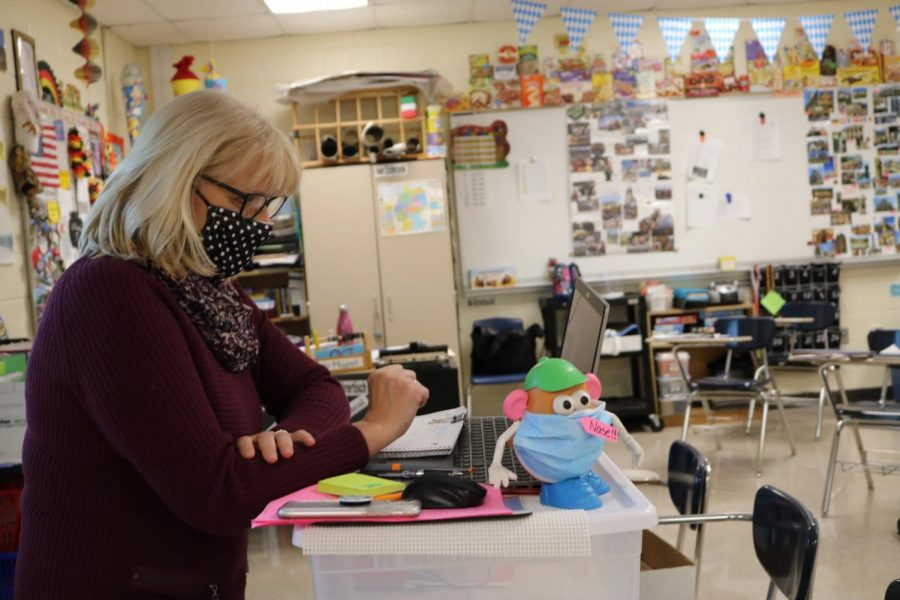 Frau König, German teacher, side by side with Kartoffelkopf, as she teaches art history to her Advanced Placement class.