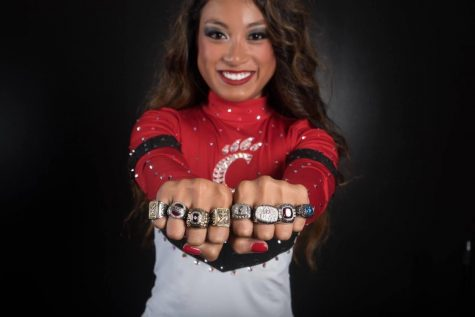 Coach Courtney Dang wearing all her national title rings.